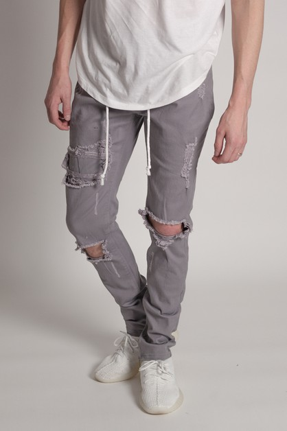 DISTRESSED ANKLE ZIP PANTS - orangeshine.com